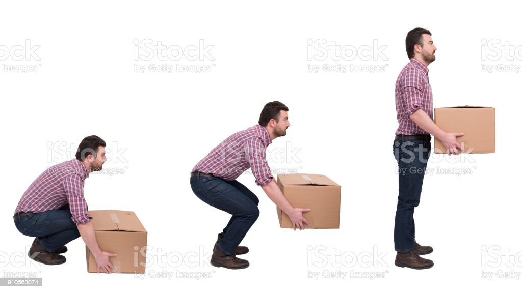 Proper heavy weight boxes lifting against backache stock photo