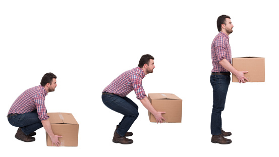 Proper Heavy Weight Boxes Lifting Against Backache Stock Photo - Download  Image Now - iStock