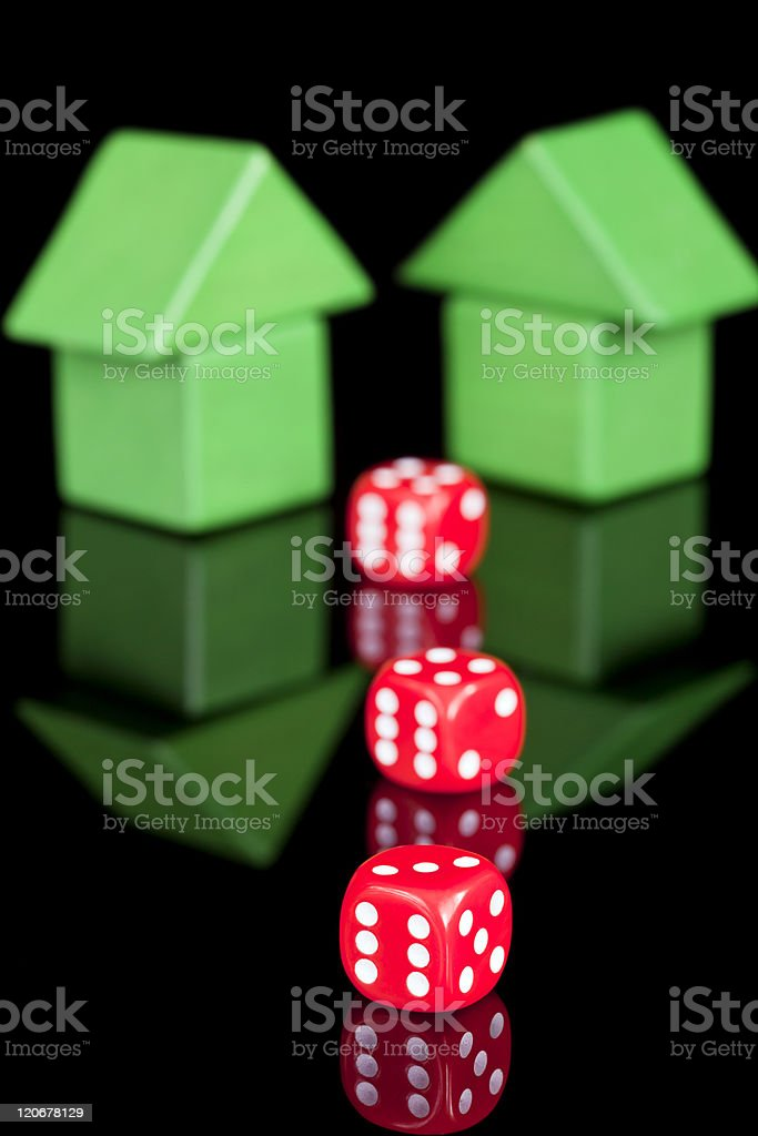 Concept shot of toy bricks in the shape of a house surrounded by...