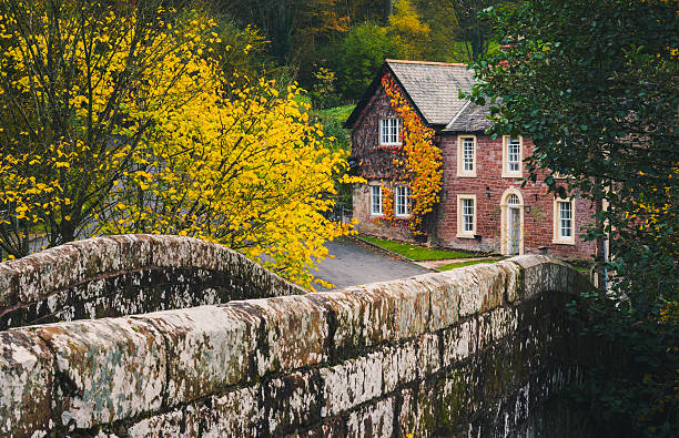 Property in Cumbrian countryside Lanercost, United Kingdom - October 30, 2016: Rural properties and old stone bridge in Cumbria near Lanercost Priory. northwest england stock pictures, royalty-free photos & images