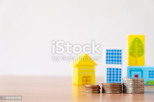 958039576 istock photo Property investment and house mortgage financial concept 1163490256