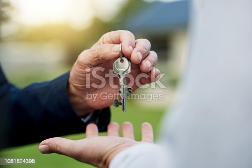 Shot of an unrecognizable person handing over a key