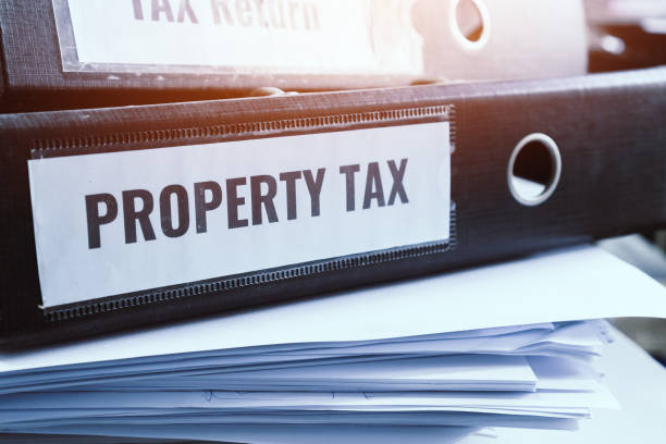 Property tax and tax return word on folders stack with label black binder on paperwork documents summary report in busy offices. HR-human resources business bookkeeping accountancy Document Concept stock photo