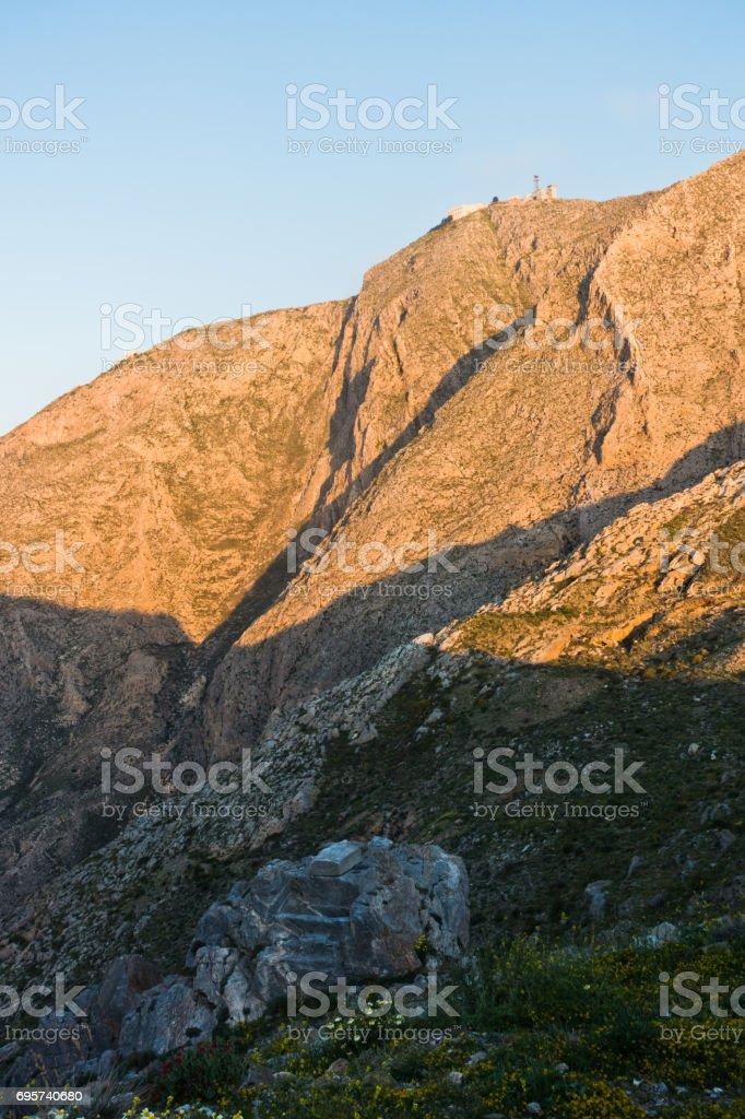 Prophet Ilias mountain and monastery at sunsrise, highest point of Santorini island stock photo