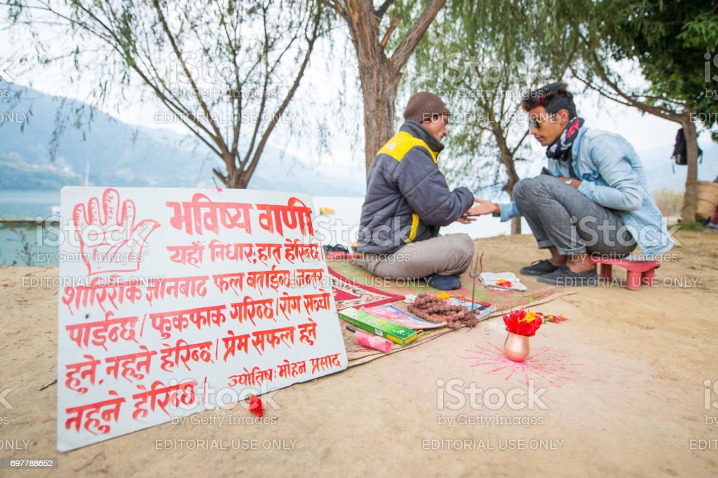 prophet see fingerprint and foretell to Nepalese man stock photo
