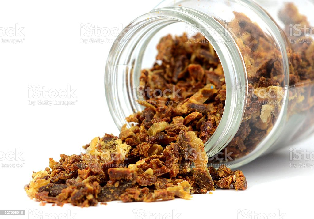 Propolis granules poured out of the jar stock photo