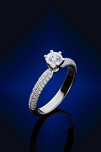 Proposal diamonds ring on blue background stock photo