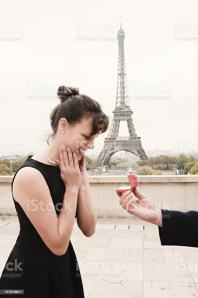 Proposal in Paris in front of Eiffel Tower, vertical. royalty-free stock photo