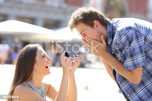 istock Proposal of a woman asking marry to a man 493658600