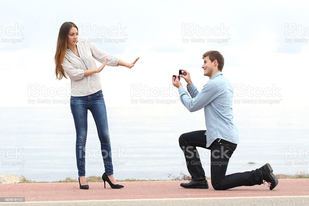 Proposal rejection when man asks in marriage to a woman stock photo