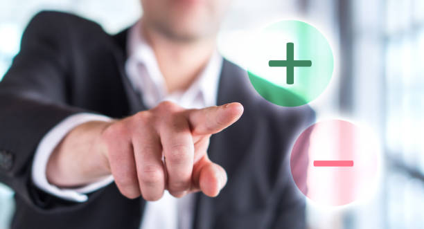 Pros and cons concept. Business man touching plus or minus symbol. Pros and cons concept. Business man touching plus or minus symbol. Choosing between two options. minus sign stock pictures, royalty-free photos & images