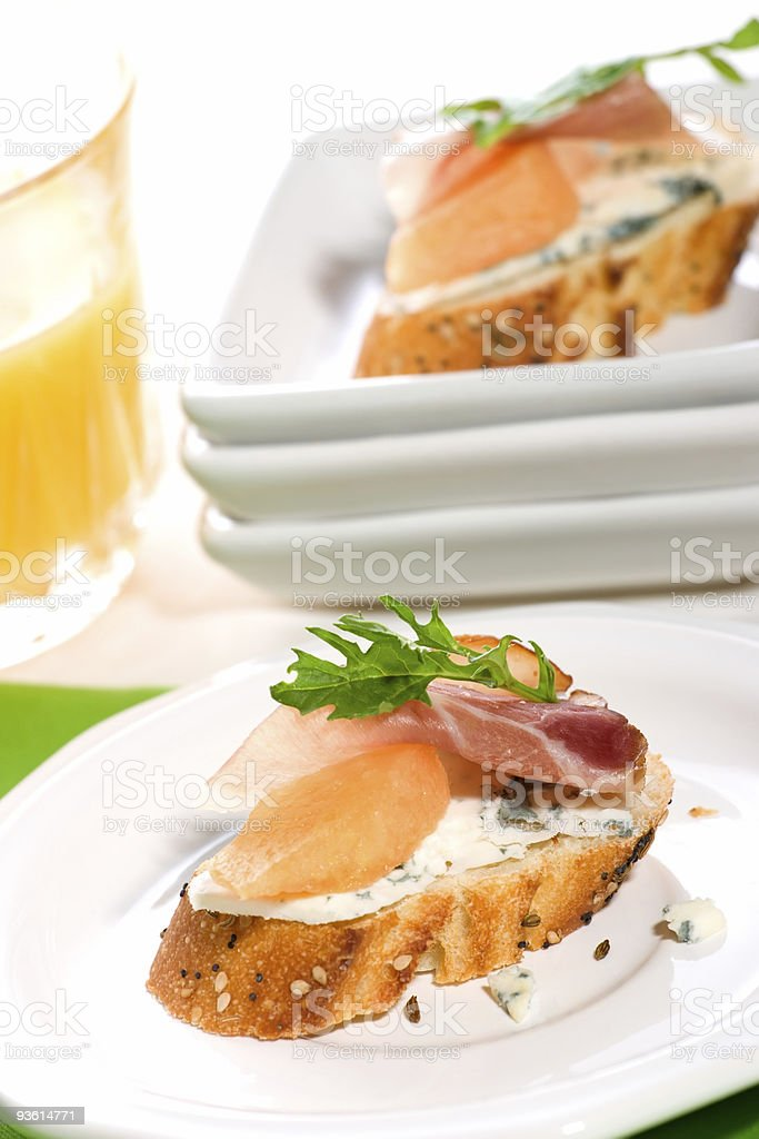 Prosciutto and blue cheese canapes royalty-free stock photo