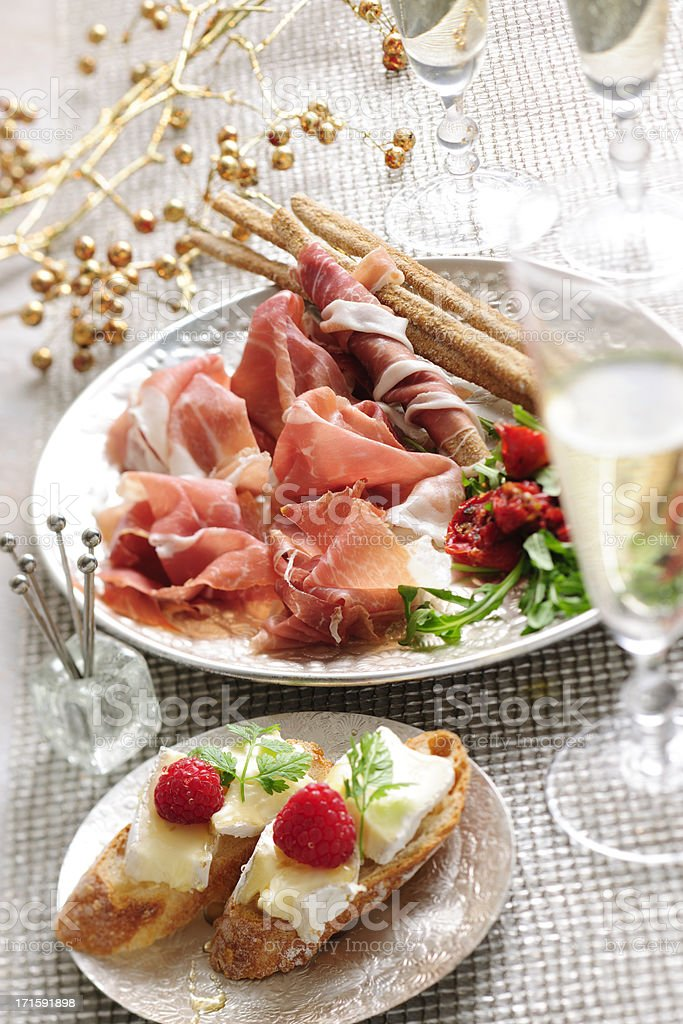 Prosciutto and Brie Cheese Canape Served on a Festive Table stock photo