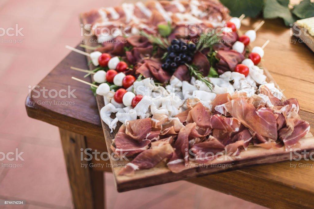 Prosciutto cheese tray decor stock photo