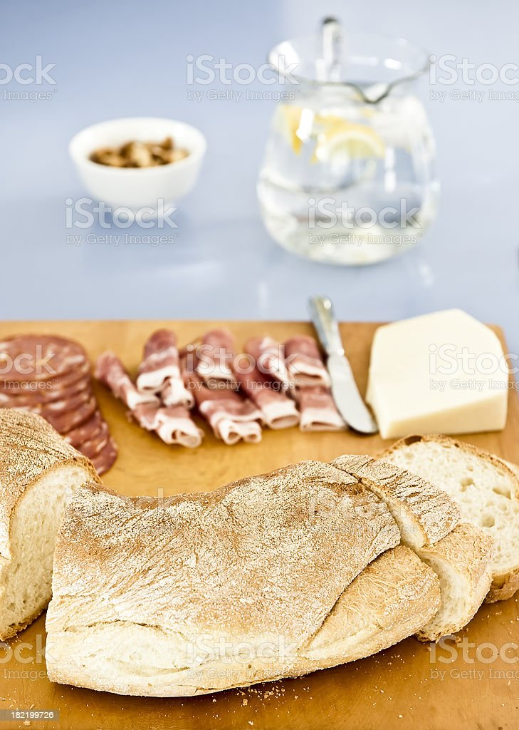 Prosciutto continental food crusty bread wooden chopping board. royalty-free stock photo