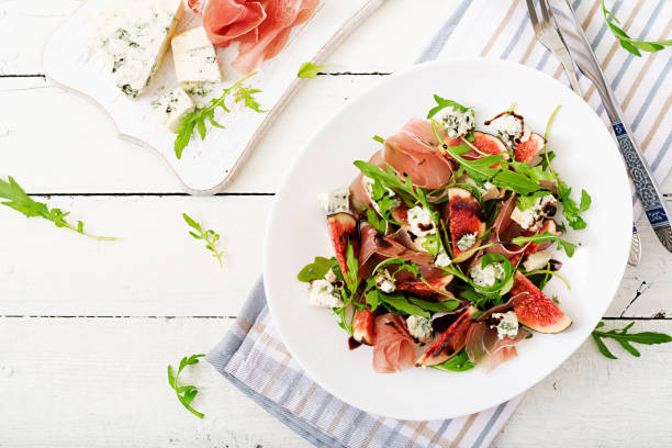 Prosciutto di Parma salad with figs and blue cheese. Flat lay. Top view stock photo