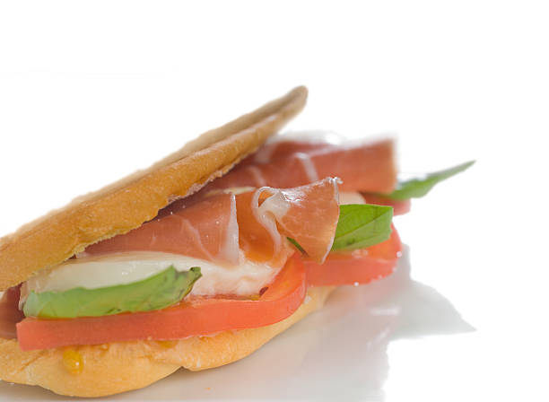 prosciutto Parma ham caprese panini with white background stock photo