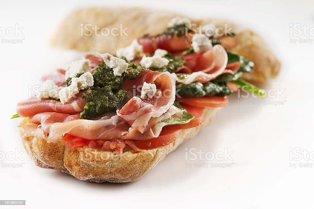 Prosciutto, Pesto and Goat Cheese Sub Sandwich royalty-free stock photo