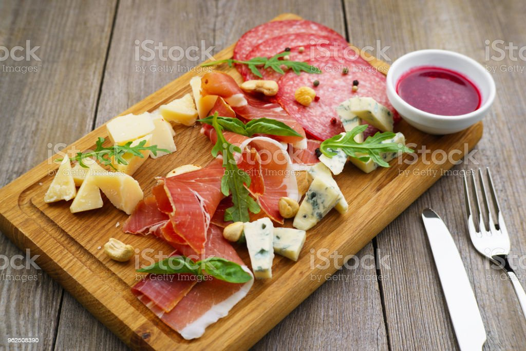 Prosciutto, salami and cheese on board, snacks set - Royalty-free Antipasto Stock Photo