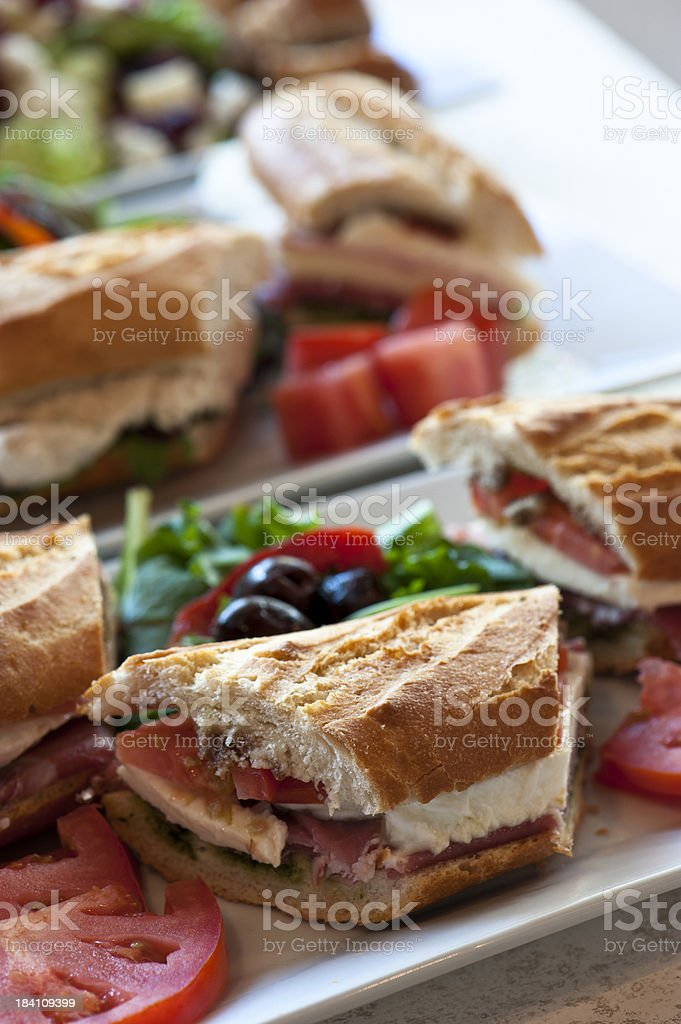 Prosciutto, tomato and mozzarella sandwich stock photo