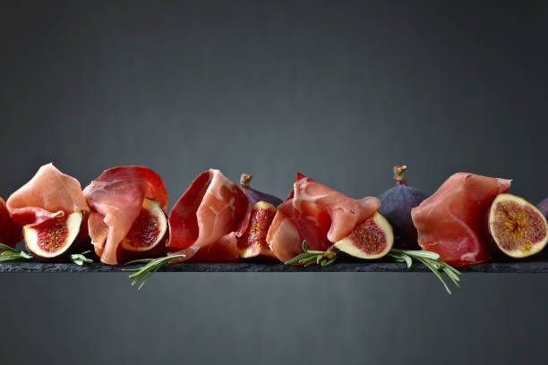 Prosciutto with figs and rosemary. stock photo