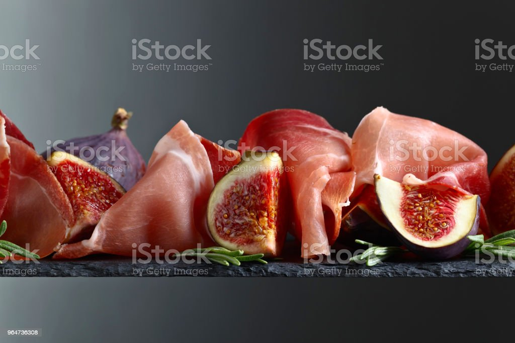 Prosciutto with figs and rosemary. royalty-free stock photo