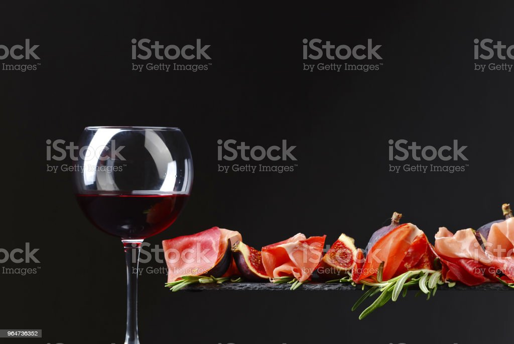 Prosciutto with figs, red wine and rosemary . royalty-free stock photo