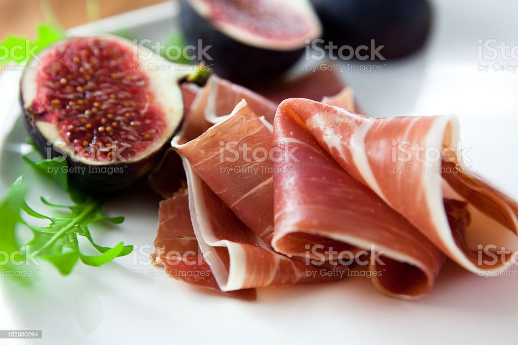 Prosciutto with fresh figs stock photo
