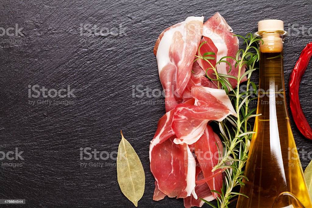 Prosciutto with rosemary and olive oil stock photo