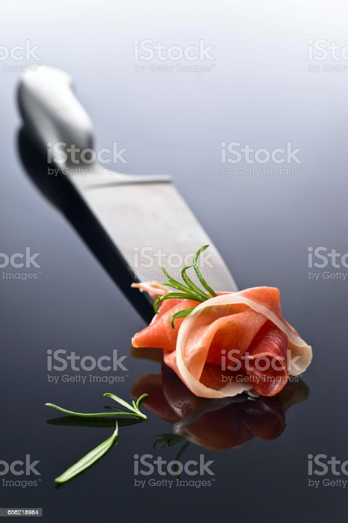 Prosciutto with  rosemary stock photo