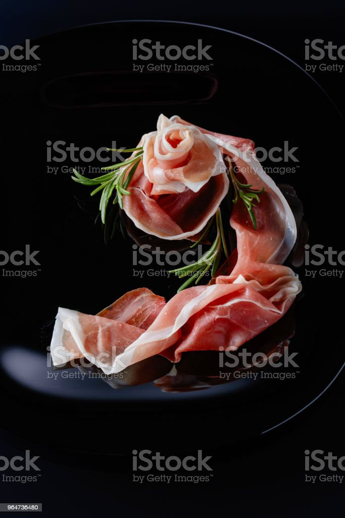 Prosciutto with rosemary. royalty-free stock photo