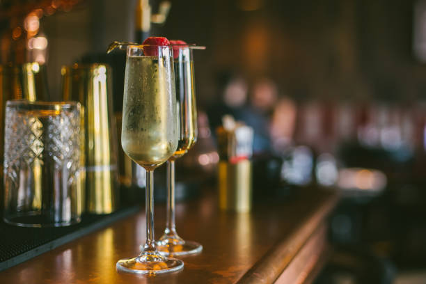 prosecco glasses for two standing on a bar stand stock photo