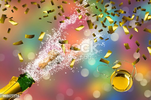 1051699126 istock photo proseeco party golden confetti 993477774