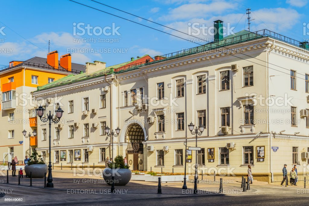 Prospect of Glory. Building with an arch vault built in the Soviet Stalin era. Old city center. Belgorod, Russia. stock photo