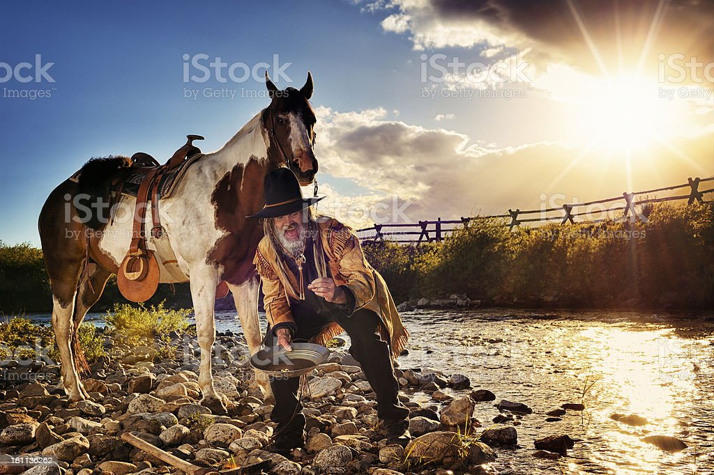 Prospector Striking It Rich While Panning For Gold stock photo