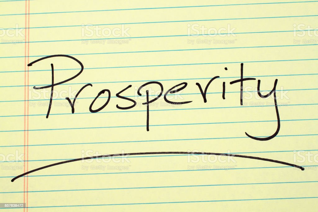 Prosperity On A Yellow Legal Pad stock photo