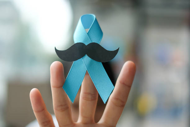Prostate Cancer Awareness, wonan hand holding light Blue Ribbon with mustache for supporting people living and illness. Men Healthcare and World cancer day concept Prostate Cancer Awareness, wonan hand holding light Blue Ribbon with mustache for supporting people living and illness. Men Healthcare and World cancer day concept prostate gland stock pictures, royalty-free photos & images