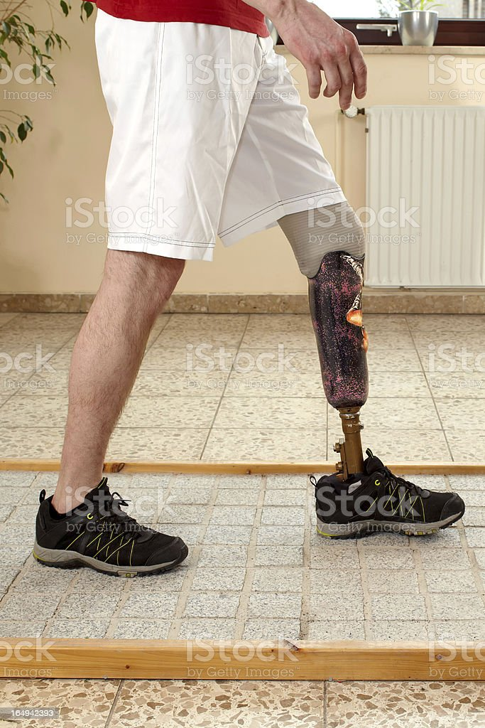 Prosthesis wearer training on diverse surfaces royalty-free stock photo