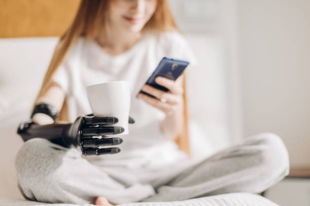 prosthetic arm controlled by brain prosthetic arm controlled by brain, blurred background, development, progress in medicine prosthetic hand stock pictures, royalty-free photos & images