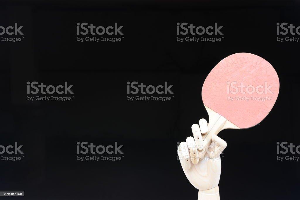 prosthetic hand holds Table Tennis Racket