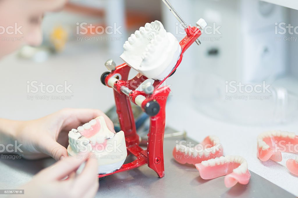 Prosthodontic lab, focus on dentures stock photo