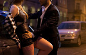 Horizontal view of prostitute flirting with businessman