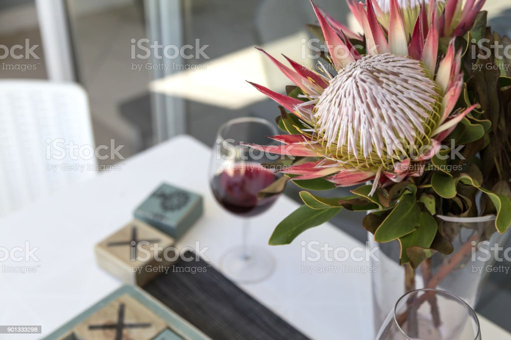 Protea and wine stock photo