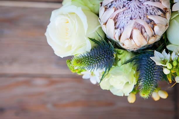 protea bouquet ready for a bride - protea strauß stock-fotos und bilder