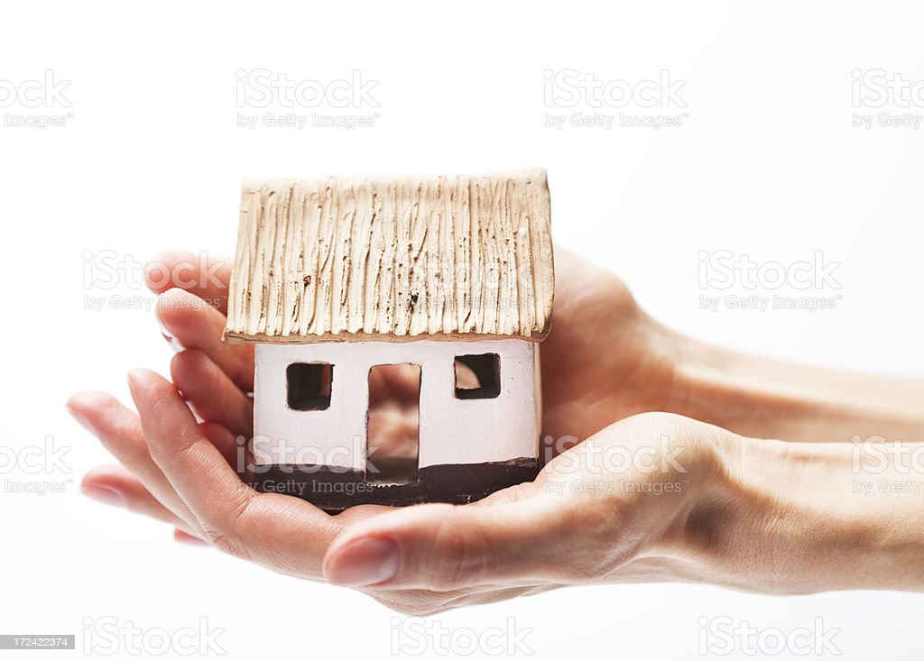 Protect Your Home Hand Holding A Small House Scale Model Stock