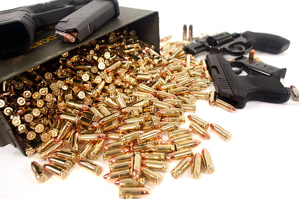Protect Yourself Assorted guns and ammunition. ammunition stock pictures, royalty-free photos & images