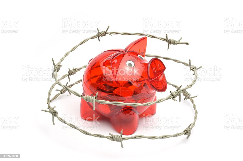 Protected or restricted funds in a piggy bank stock photo