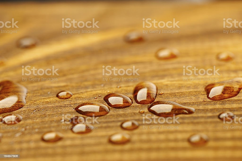 Protected wood after rain - covered with water drops royalty-free stock photo