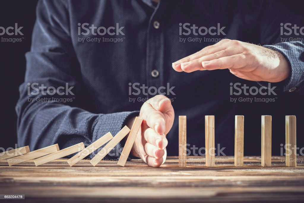 Protecting Assets From Domino Effect. Stop Loss Concept. stock photo