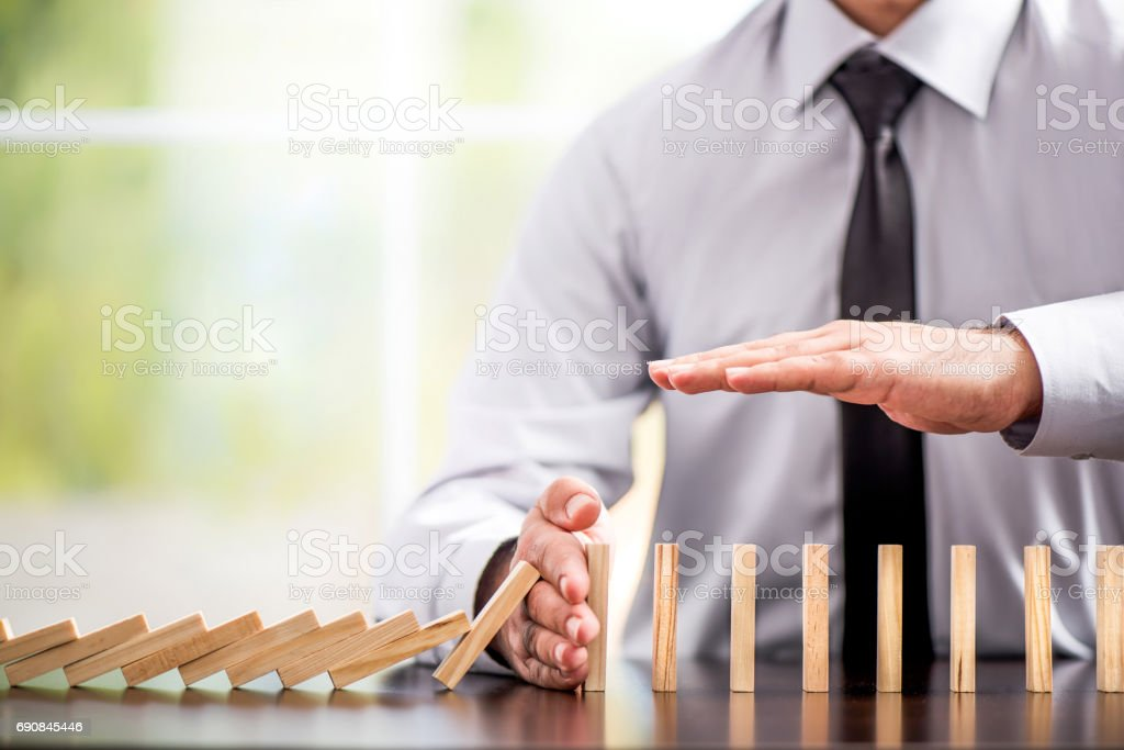 Protecting Assets From Domino Effect. Stop Loss Concept. Protecting Assets From Domino Effect. Stop Loss Concept For Stock Exchange Market. Acting - Performance Stock Photo